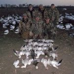 Here is a group of hunters with an average day in the field chasing snow geese.
